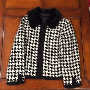 A black and white Jackie O look zip up jacket.